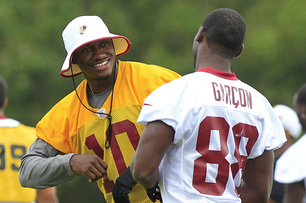 Pierre Garcon says RG3 'can't run as fast as this year' because…