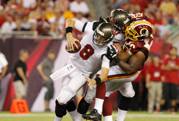 Redskins linebacker Rob Jackson tackles two Buccaneers … at the…