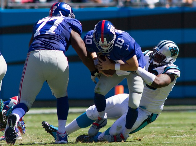 Watch the Carolina Panthers sack Eli Manning all seven times on…
