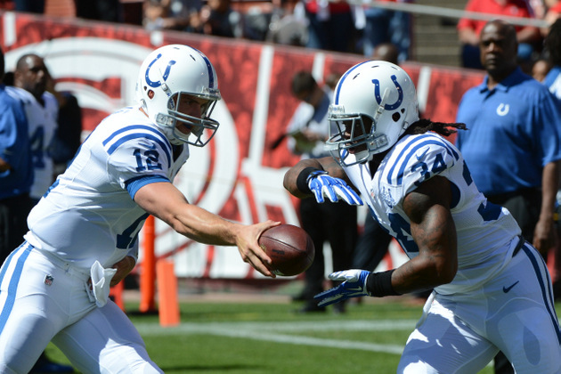 Trent Richardson scores a touchdown on his first carry with the…