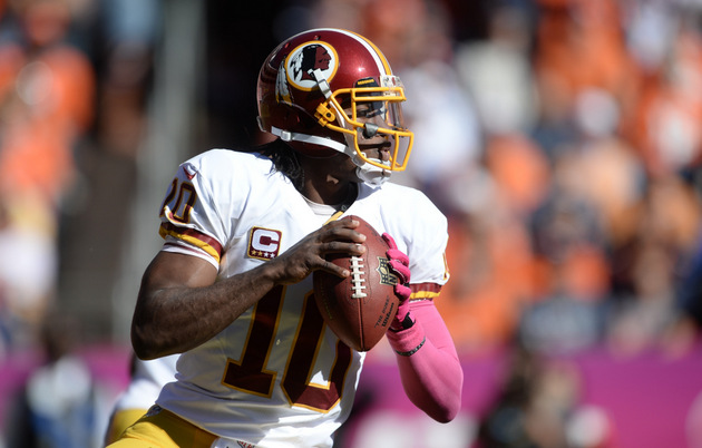 Robert Griffin III gets pounded into the turf, holds knee, gets…