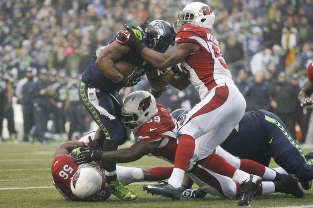 Seahawks' offensive line gets dominated by Cardinals