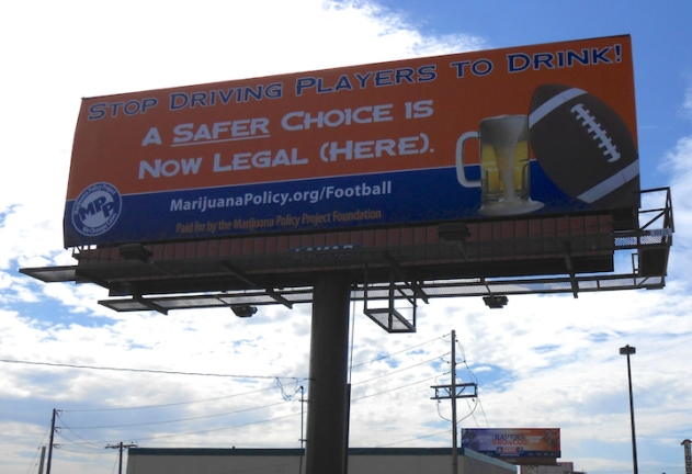 Billboard by Broncos stadium encourages league to let players u…