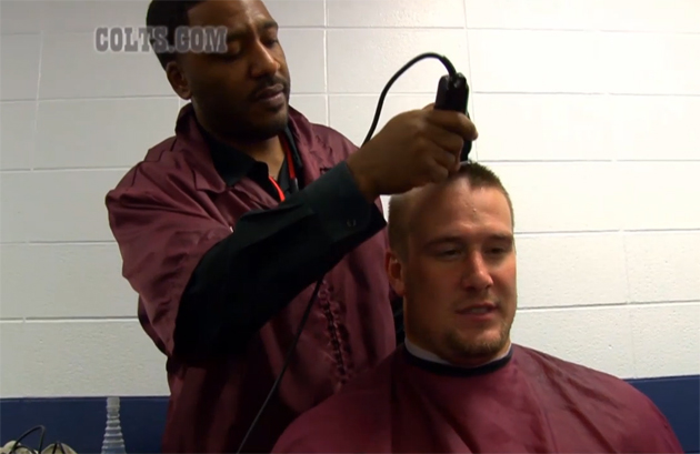 Over two dozen Colts players shave their heads in support of Ch…
