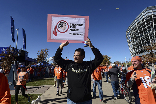 Redskins name protestors approach team bus in Denver