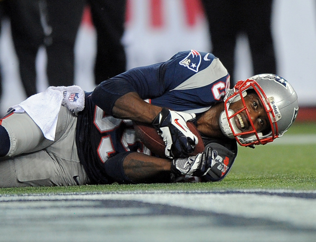 Brandon Lloyd gets a 15-yard penalty for throwing the ball at a…