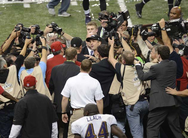 John and Jim Harbaugh share sweet but awkward exchange after Ra…