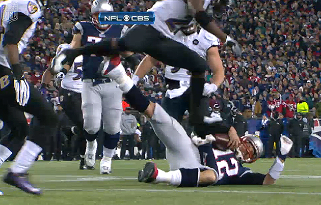 Tom Brady karate-kicks Ed Reed, upends Reed in the process