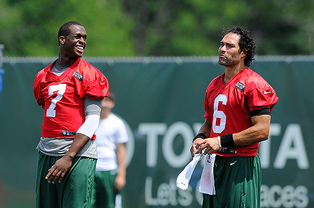 Michael Vick, Mark Sanchez take early leads in training camp qu…