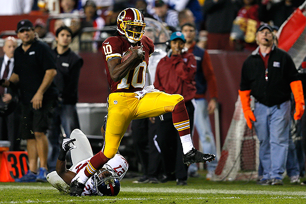 Robert Griffin III helps Redskins keep playoff hopes alive with…