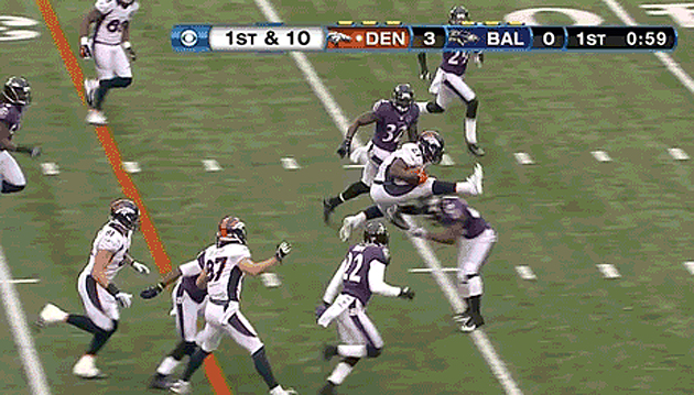 Knowshon Moreno jumps over Ed Reed like a hurdle during 20-yard…