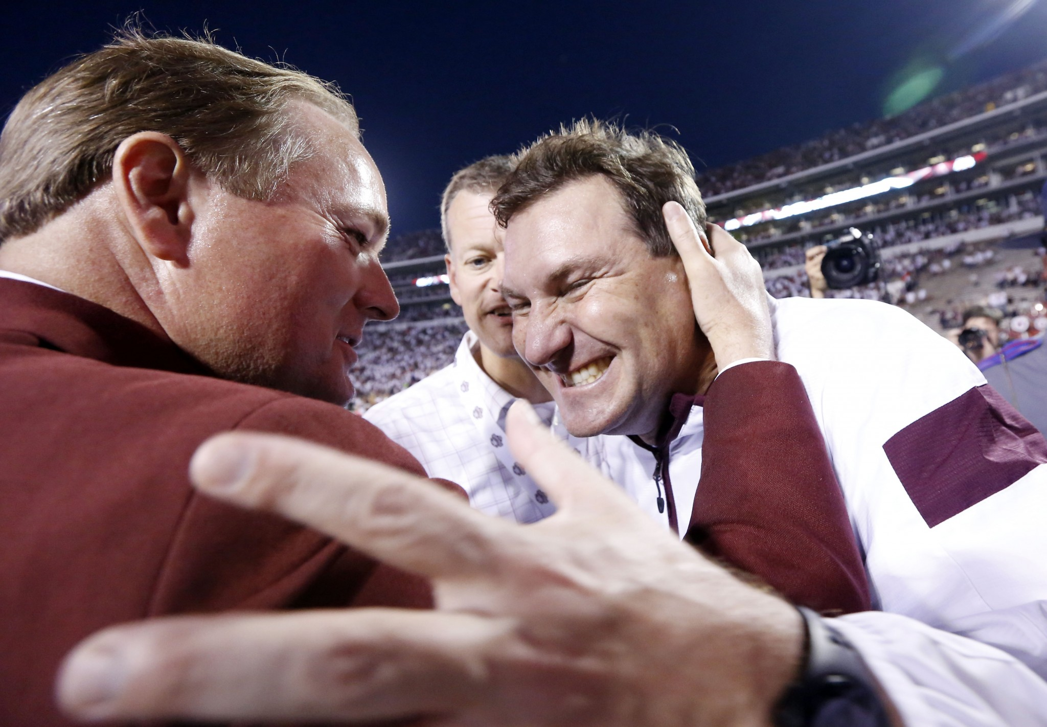 Scott Stricklin, left, has been Mississippi State's athletic director since 2010. (AP Photo/Rogelio V. Solis)