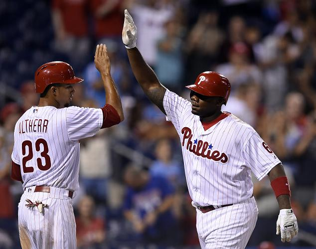 Ryan Howard of the Phillies celebrates his 14th career grand slam. (AP)