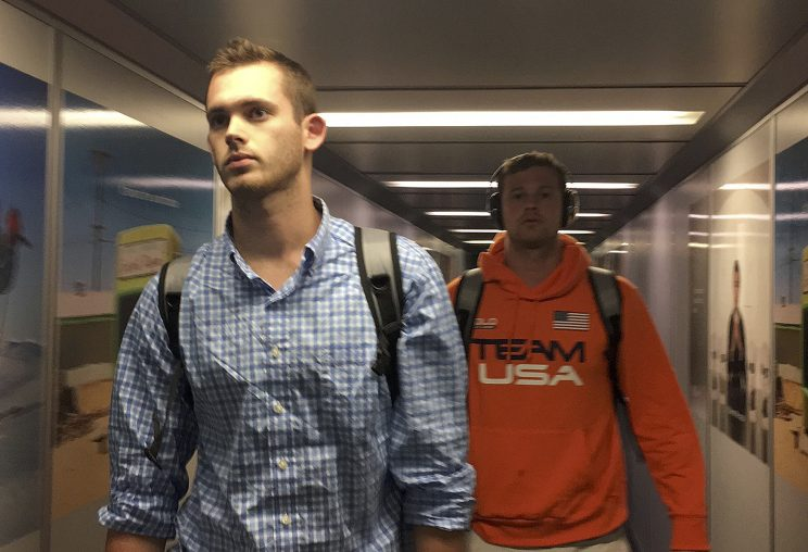 U.S. Olympic swimmers Jack Conger and Gunnar Bentz arrive at the Miami international airport from Rio de Janeiro a day after Brazilian police detained their passports and questioned them, in Miami, Aug. 19, 2016. (Photo: Cassandra Garrison/Reuters)