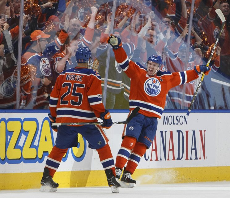 Edmonton Oilers' Darnell Nurse (25) and Connor McDavid (97) celebrate a goal against the San Jose Sharks during the third period of Game 2 of an NHL hockey Stanley Cup first-round playoff series Friday, April 14, 2017, in Edmonton, Alberta. (Jason Franson/The Canadian Press via AP)