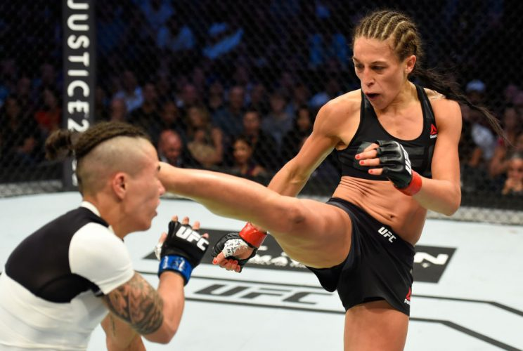 Joanna Jędrzejczyk (R) is the only strawweight champ the UFC has ever known. (Getty)