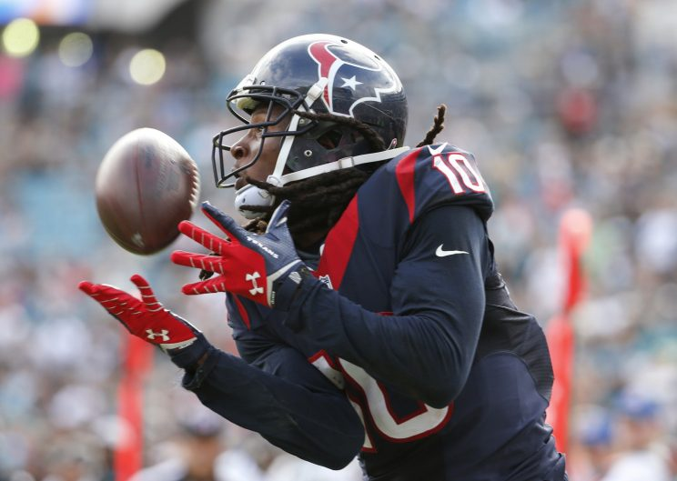 After a brief holdout, DeAndre Hopkins will report to Texans camp (AP)