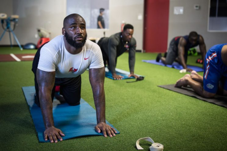 Bucs players readying for season by sweating in yoga studio