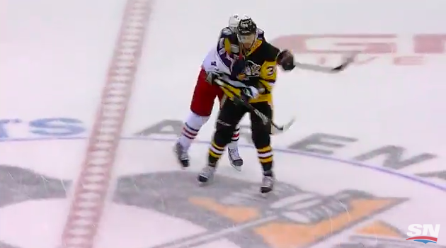 Screen shot of Matt Calvert breaking his stick on Tom Kuhnhackl.