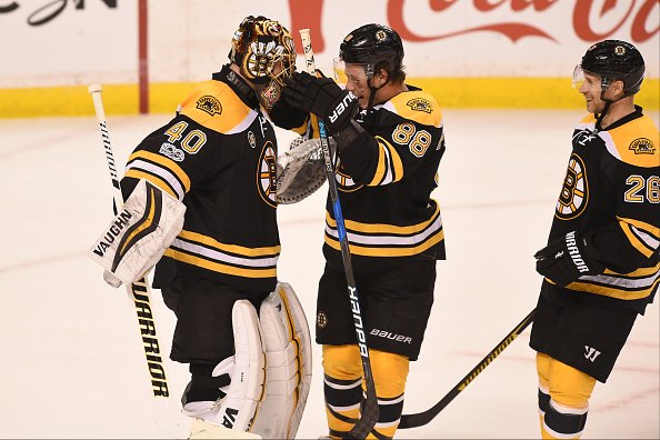 BOSTON, MA - APRIL 4: Tuukka Rask #40, David Pastrnak #88 and John-Michael Liles #26 of the Boston Bruins celebrate a shut out win and a clinched play off spot against the Tampa Bay Lightning at the TD Garden on April 4, 2017 in Boston, Massachusetts. (Photo by Steve Babineau/NHLI via Getty Images)