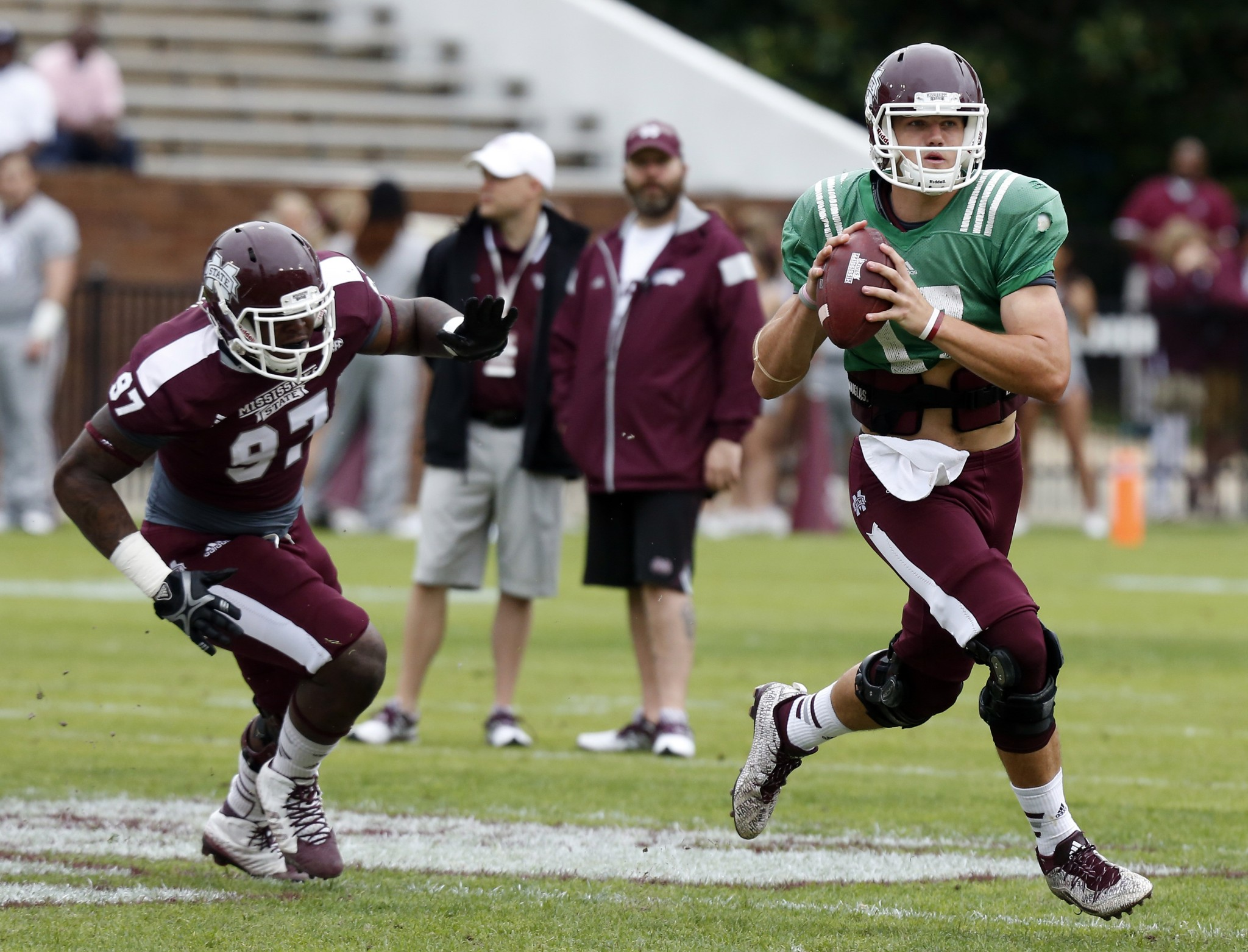 Mississippi State White Team quarterback Nick Fitzgerald (17) looks for an open receiver as Maroon Team defensive lineman Johnathan Calvin (97) closes in during their spring NCAA college football game, Saturday, April 18, 2015, in Starkville, Miss. White won 28-24. (AP Photo/Rogelio V. Solis)