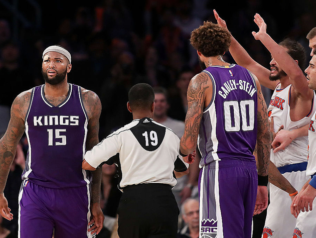 DeMarcus Cousins and Joakim Noah trade fours. (Getty Images)