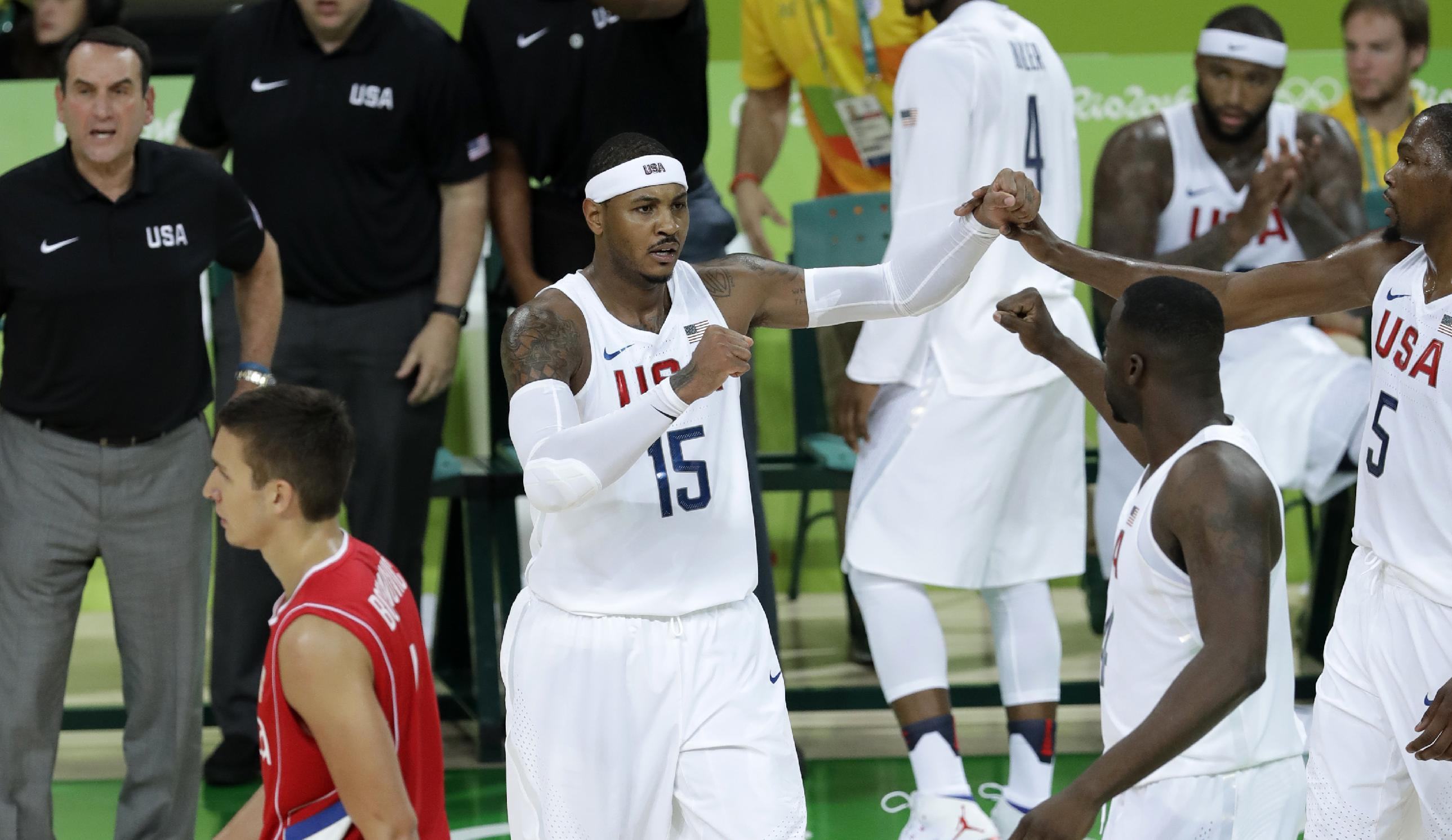 Carmelo Anthony and Team USA survived a scare against Serbia. (AP)