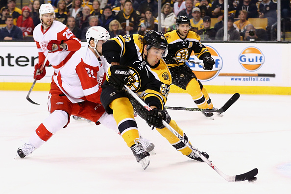 Brad Marchand agrees to eight-year, $49M contract with Bruins