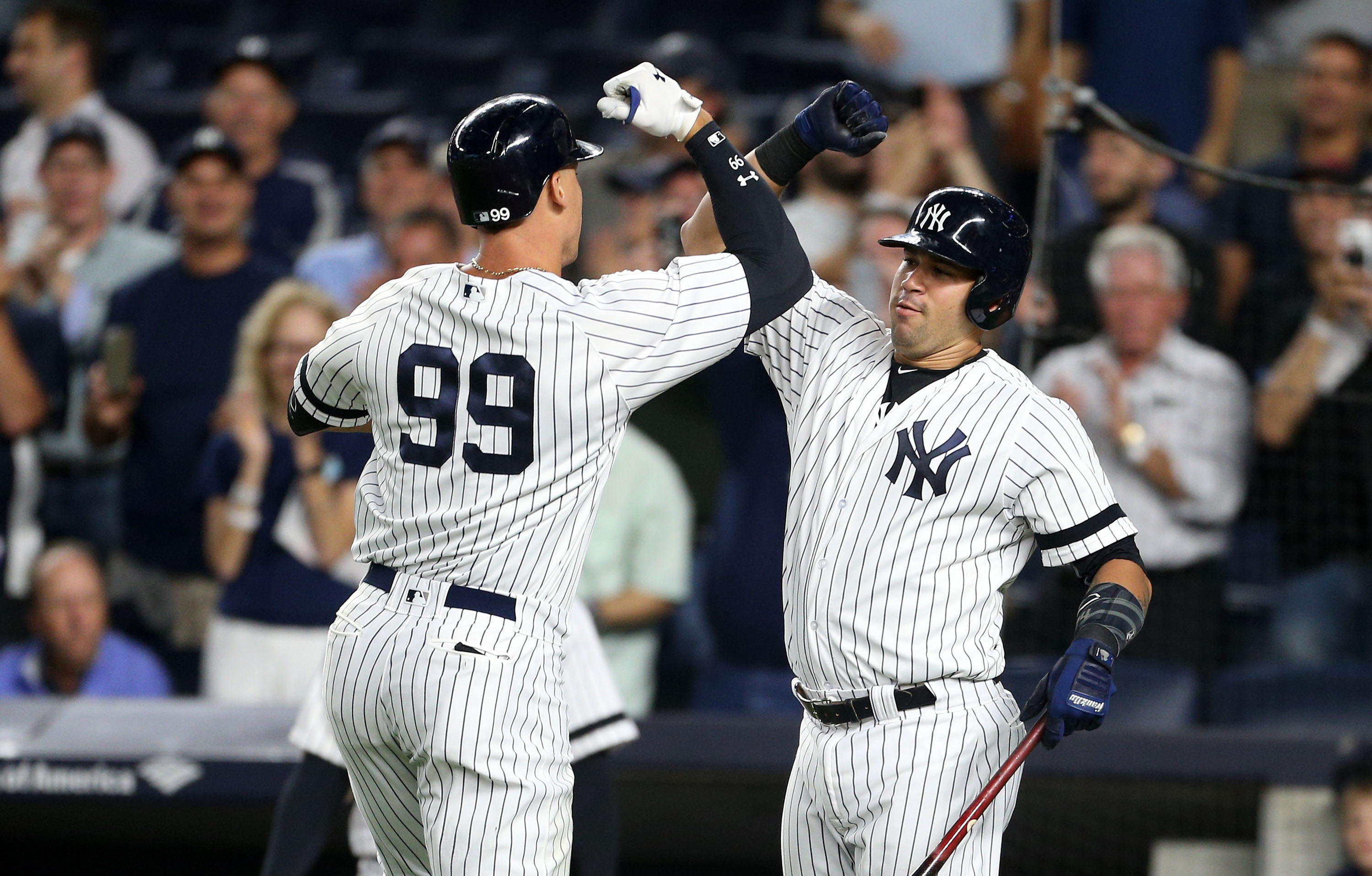Aaron Judge (left) and Gary Sanchez celebrate Judge's homer Monday night. (Getty Images)