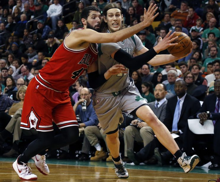 Nikola Mirotic and Kelly Olynyk battle it out for their next big contract. (AP)