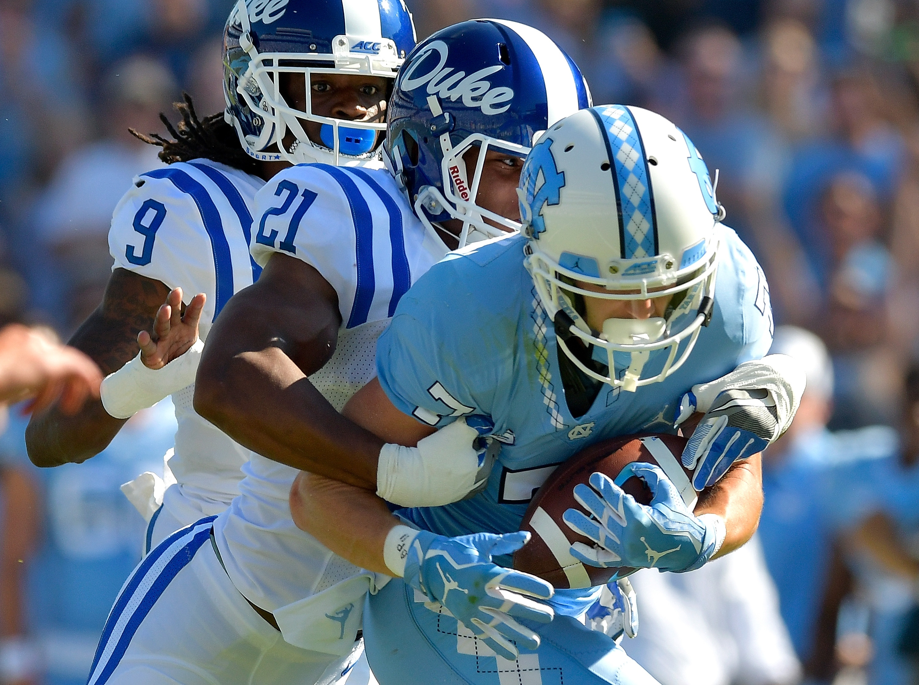 CHAPEL HILL NC – SEPTEMBER 23 Alonzo Saxton II 21 of the Duke Blue Devils tackles Austin Proehl 7 of the North Carolina Tar Heels during their game at