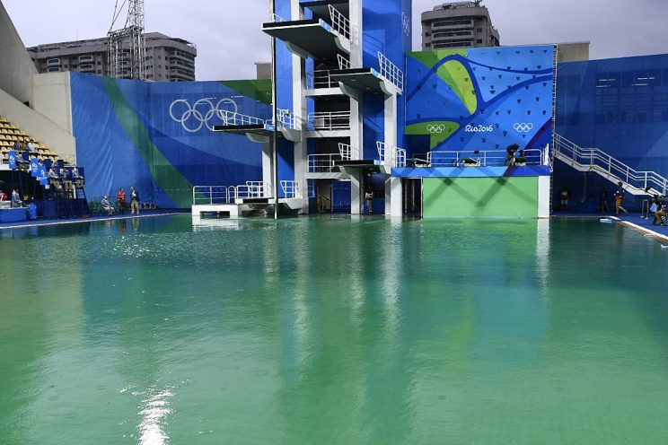 A picture taken on August 10, 2016 at the Maria Lenk Aquatics Stadium in Rio de Janeiro shows the diving pool of the Rio 2016 Olympic Games. Red-faced Rio Olympics organisers anxiously waited for the diving water to turn back from a nervy green to classic blue as a lack of chemicals was revealed as the cause of the colour changes. Heavy rain slowed the flow of new chemicals added to the water which was also green in the pool used for the synchronised swimming and water-polo. / AFP / CHRISTOPHE SIMON (Photo credit should read CHRISTOPHE SIMON/AFP/Getty Images)