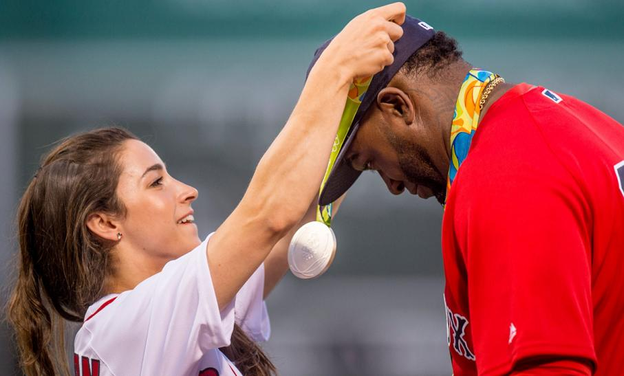 US gymnast Aly Raisman places one of her six Olympic medals around the neck of David Ortiz. (Red Sox on Twitter)