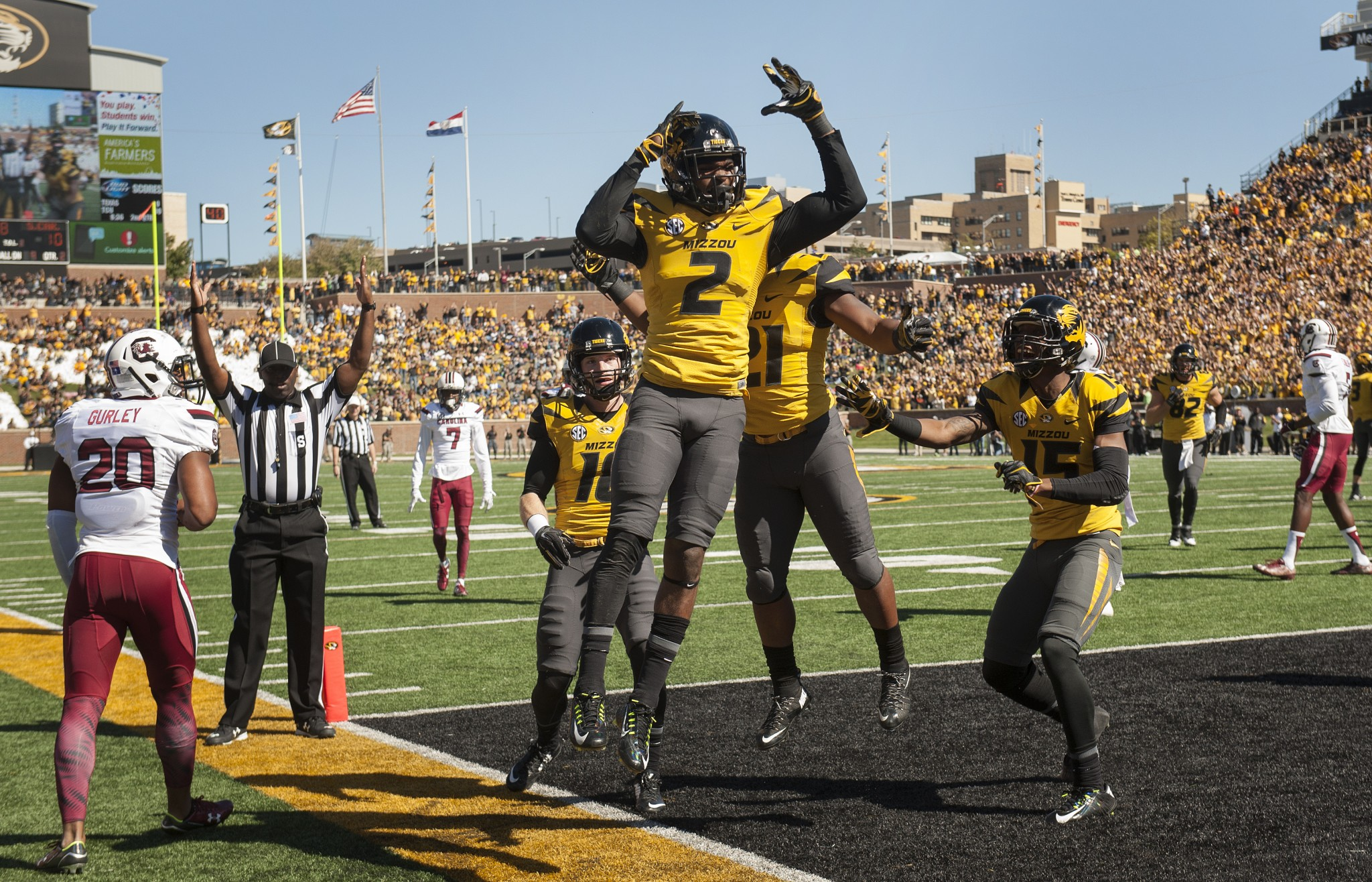 Missouri wide receiver Nate Brown, center, celebrates with teammates after he caught a touchdown pass over South Carolina safety T.J. Gurley, left, during the second quarter of an NCAA college football game Saturday, Oct. 3, 2015, in Columbia, Mo. (AP Photo/L.G. Patterson)