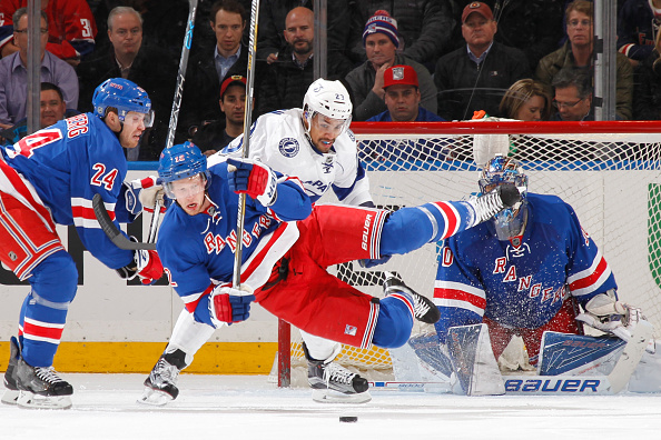 NEW YORK, NY - APRIL 05: Eric Staal #12 of the New York Rangers gets airborne after being tripped by J.T. Brown #23 of the Tampa Bay Lightning at Madison Square Garden on April 5, 2016 in New York City. (Photo by Jared Silber/NHLI via Getty Images)