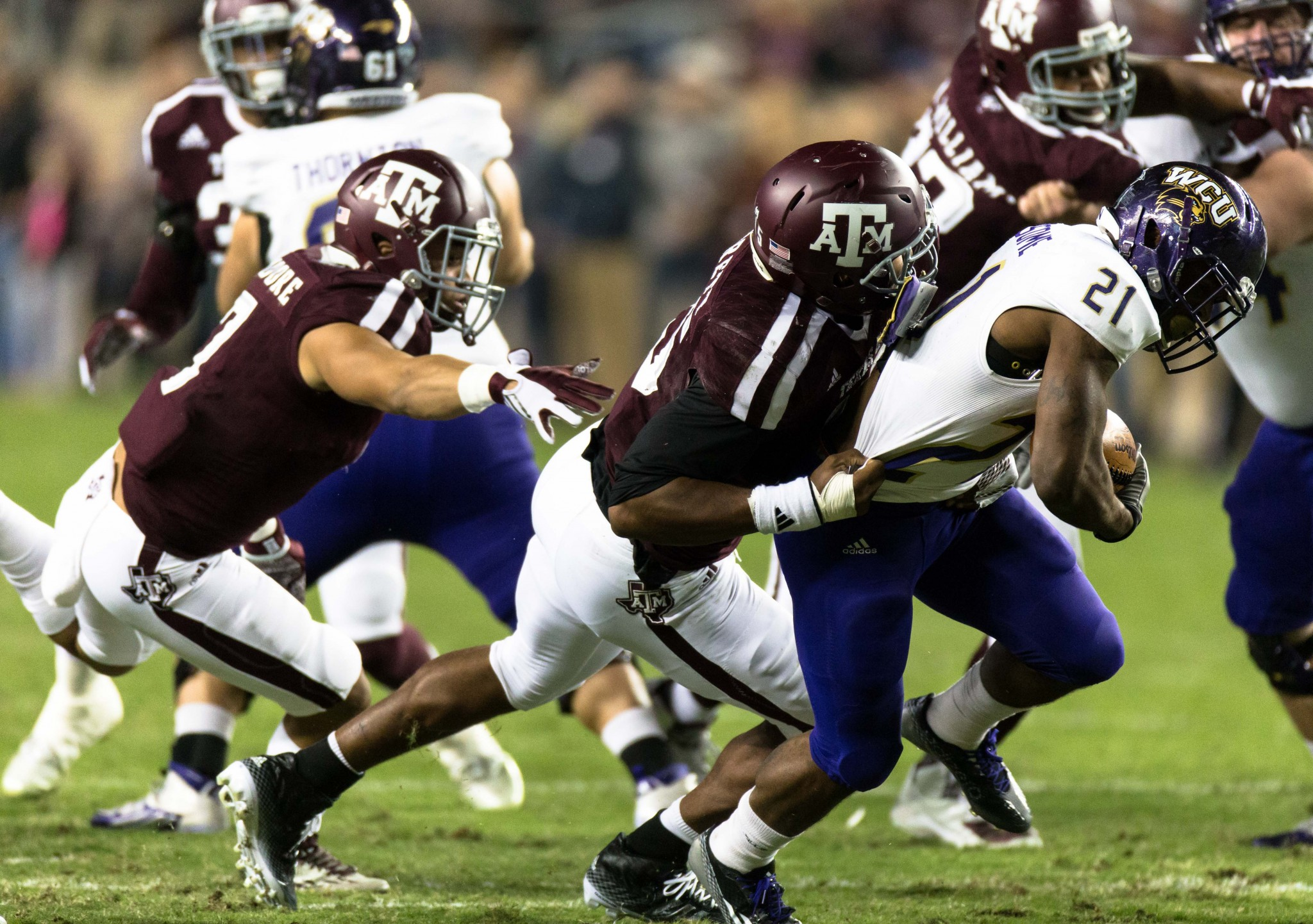 Texas A&M's Myles Garrett, left, tackles Western Carolina's Detrez Newsome (21) during the first half of an NCAA college football game Saturday, Nov. 14, 2015, in College Station, Texas. Texas A&M defeated Western Carolina 41-17. (AP Photo/Juan DeLeon)