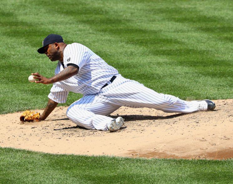 CC Sabathia takes a tumble off the mound while throwing pitch