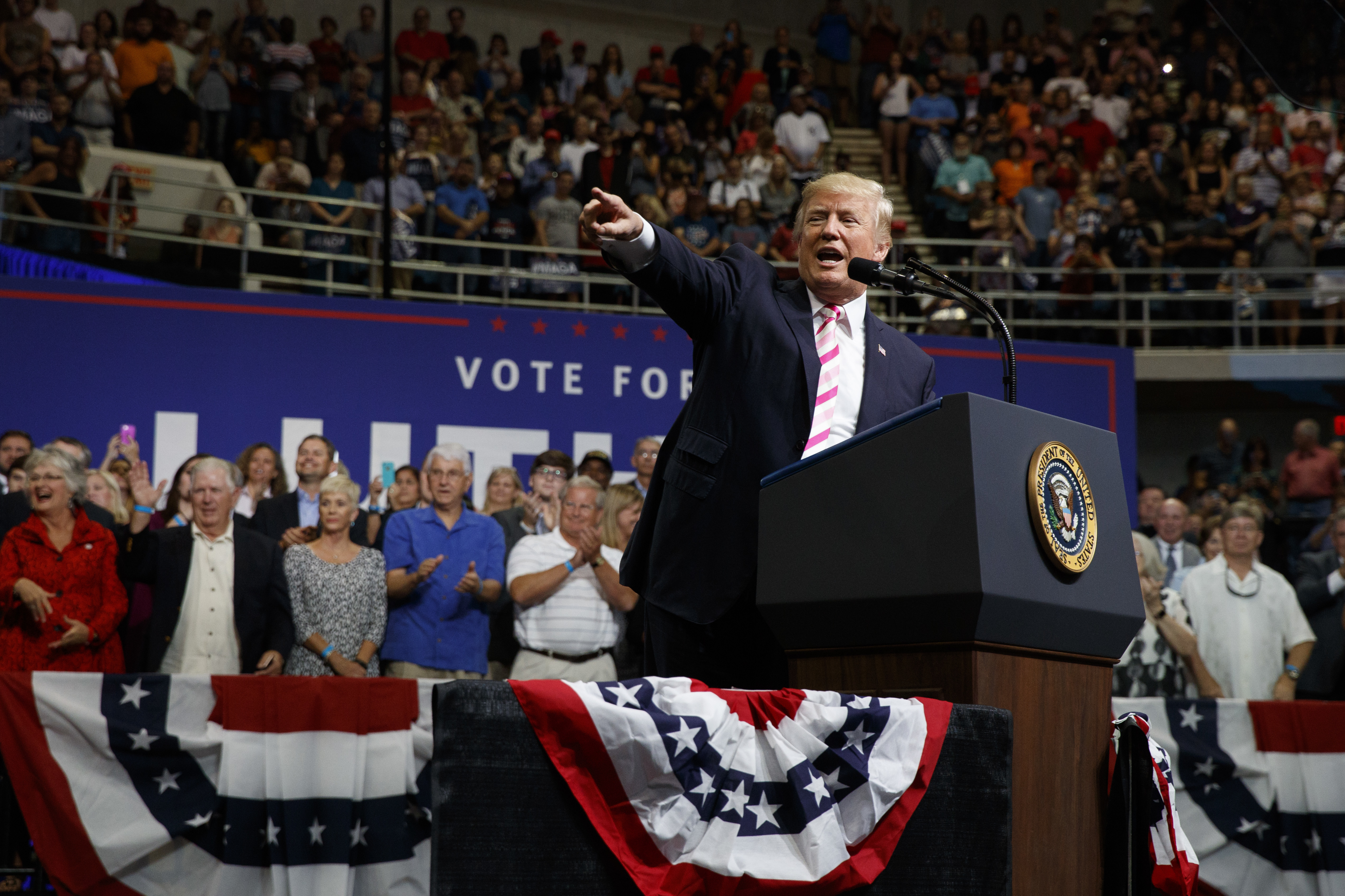 President Trump decries NFL player anthem protests, policing of hard hits in Alabama rally