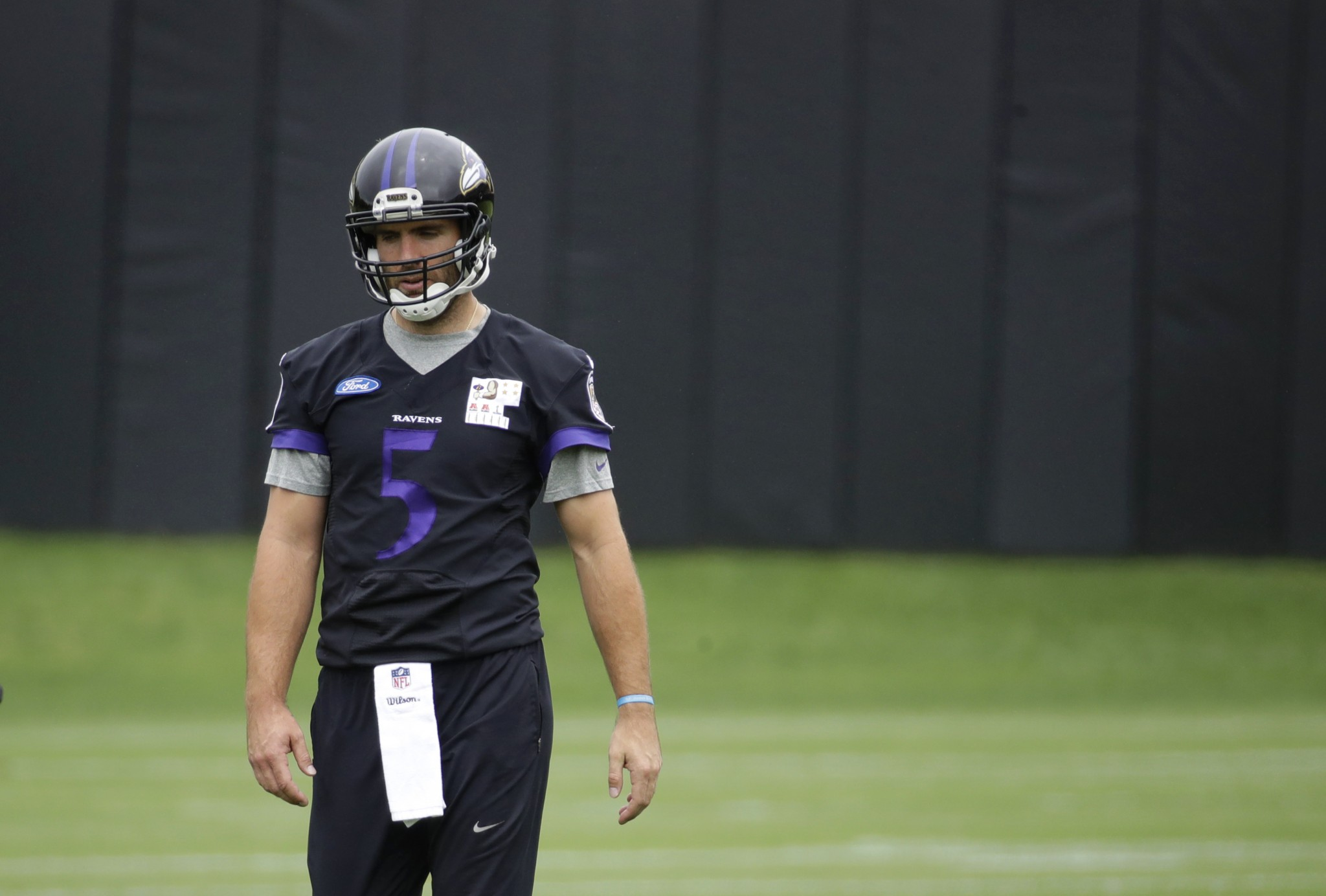The Ravens open training camp on Thursday, but QB Joe Flacco is dealing with a back issue. (AP)
