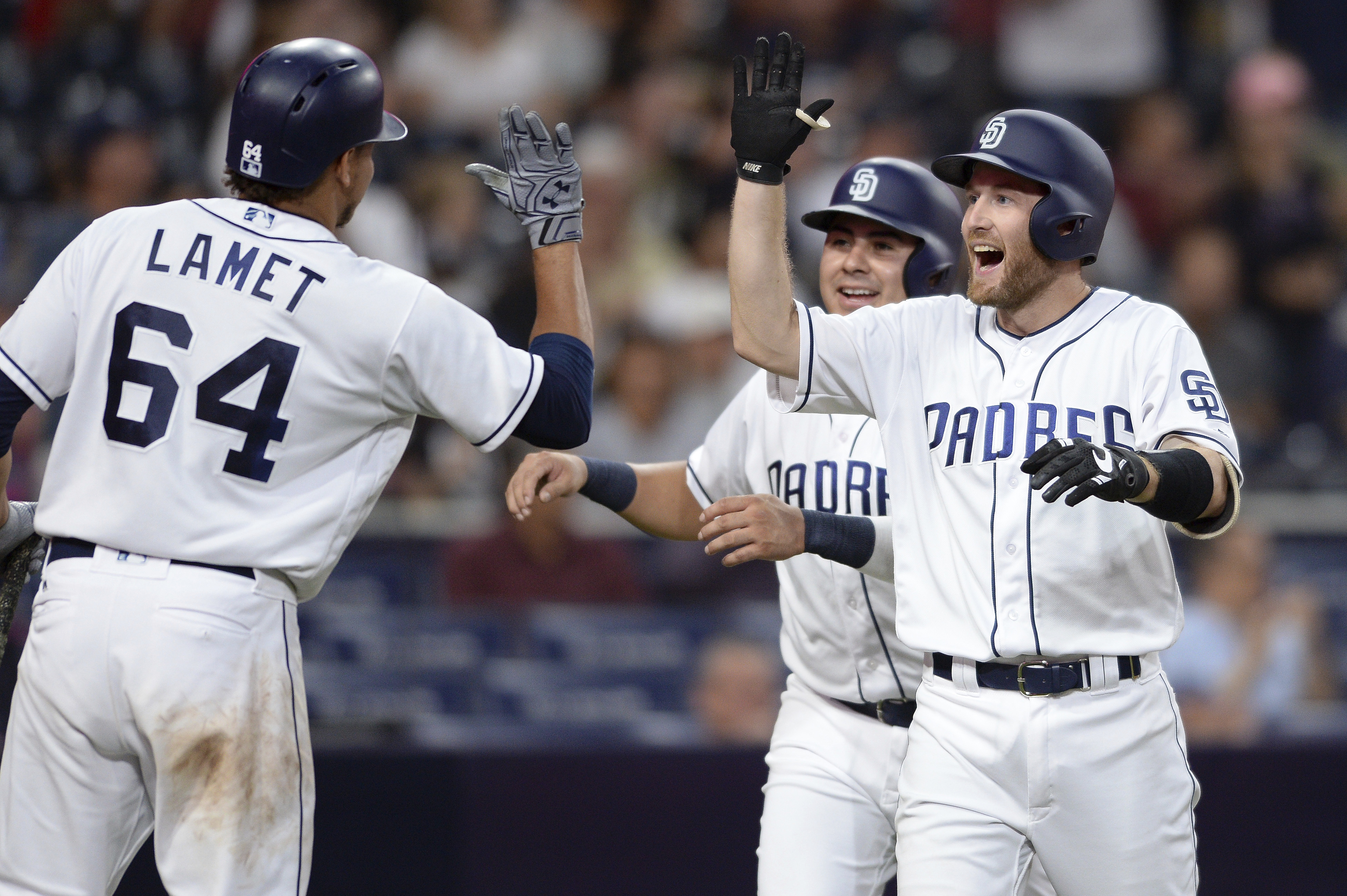 Padres' rookie Rocky Gale (far right) is congratulated at home plate after hitting his first career home run against Arizona. (AP)