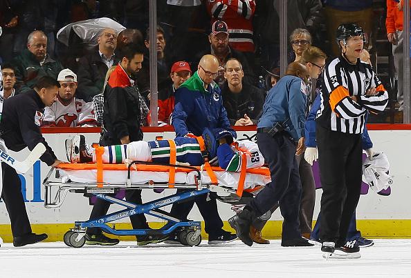 Canucks' Philip Larsen stretchered off after Taylor Hall hit (V…