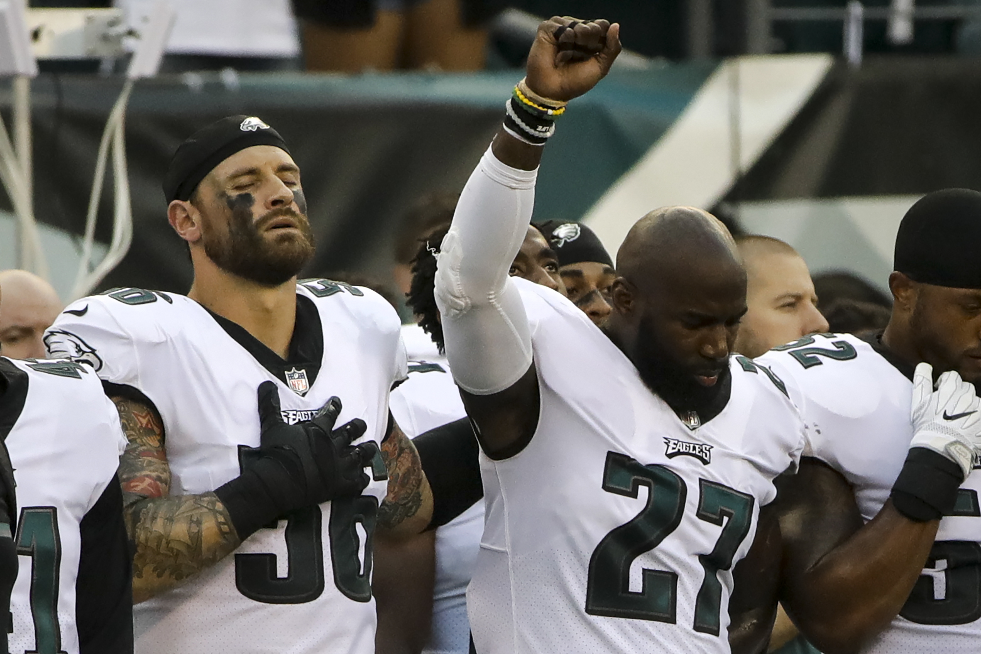 Philadelphia Eagles' Chris Long (56) stands beside Malcolm Jenkins (27) as he raises his fist during the national anthem before a preseason game. (AP)