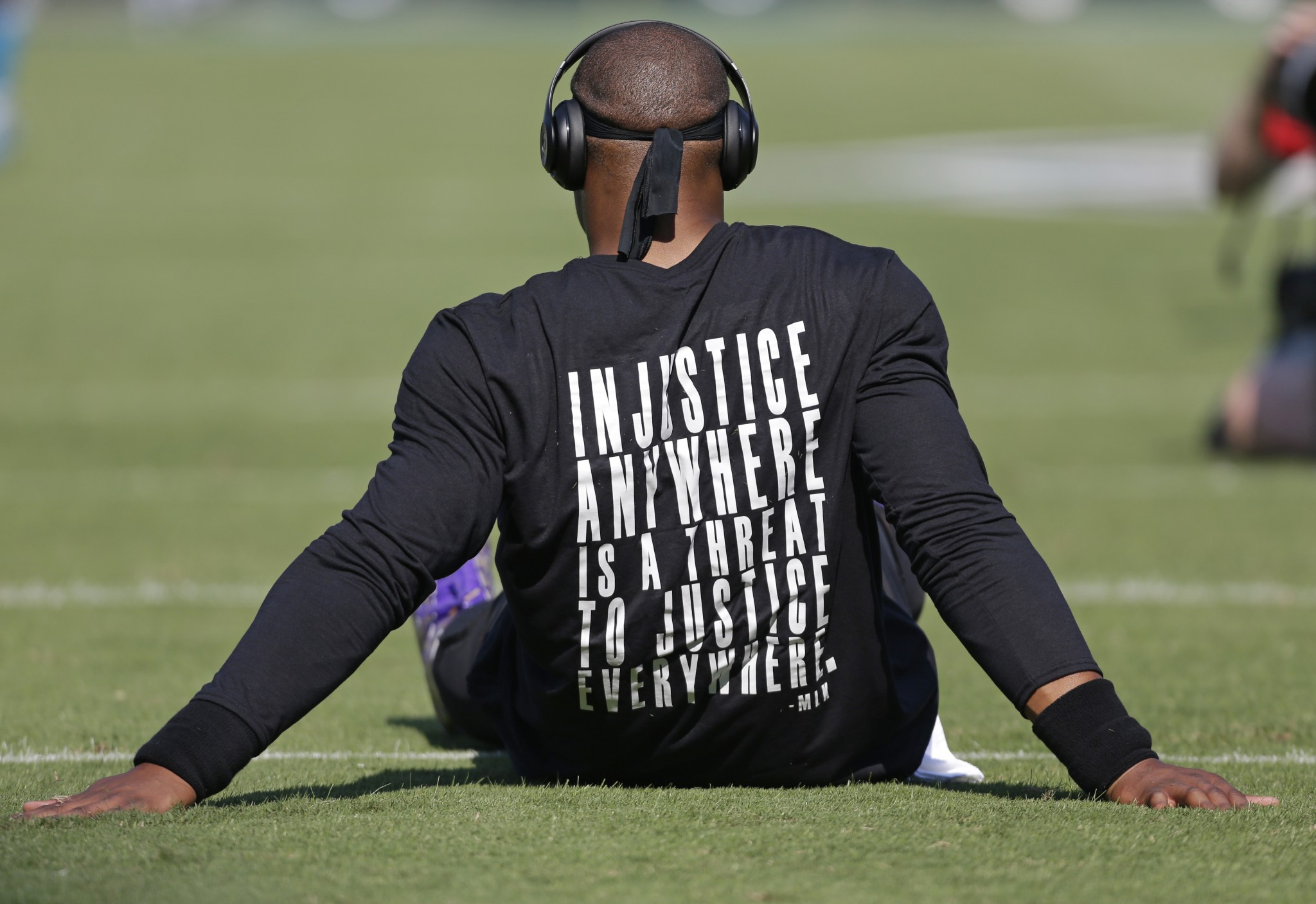 Cam Newton wears MLK shirt, Prince shoes during pregame warmups