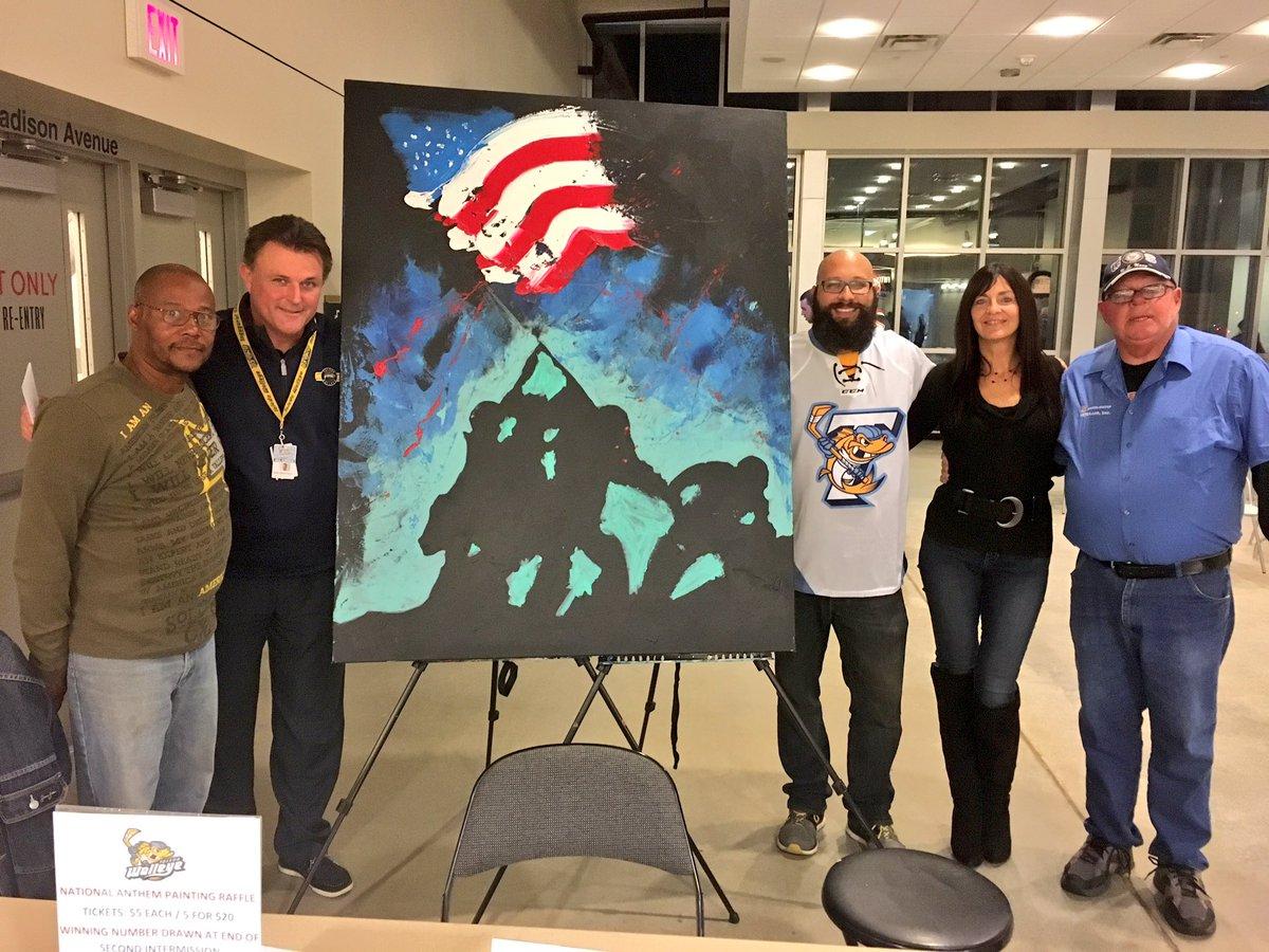 Toledo anthem singer paints portrait while singing (Video)