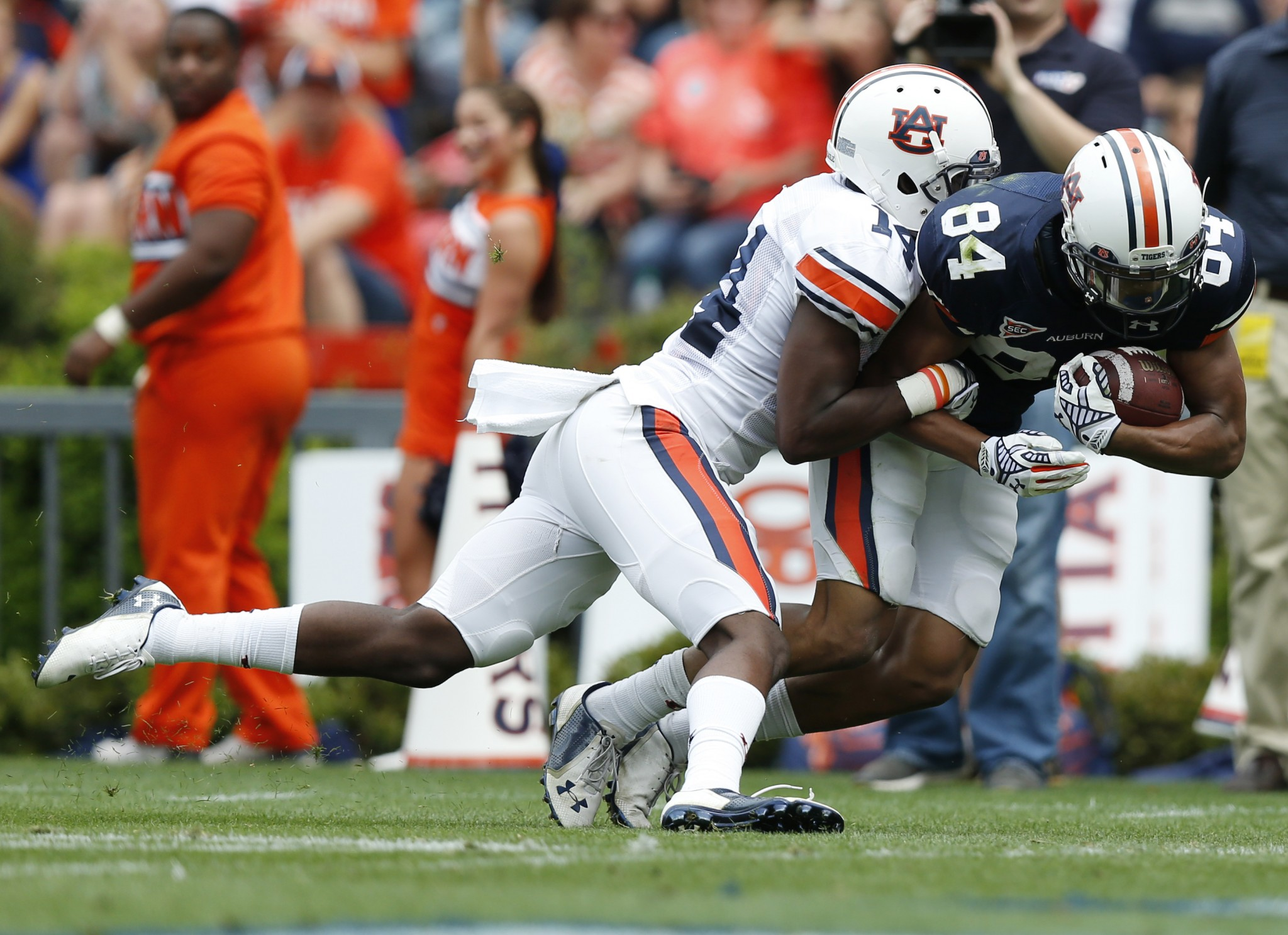 Auburn receiver Myron Burton Jr. (84) scores against Auburn Stephen Roberts (14) during their spring game. (AP Photo/Brynn Anderson)