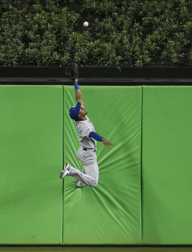 Jarrod Dyson robs the first home run in Marlins Park history. (AP Images/Wilfredo Lee)