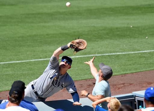 Logan Morrison tears apart Dodger Stadium to make crazy catch
