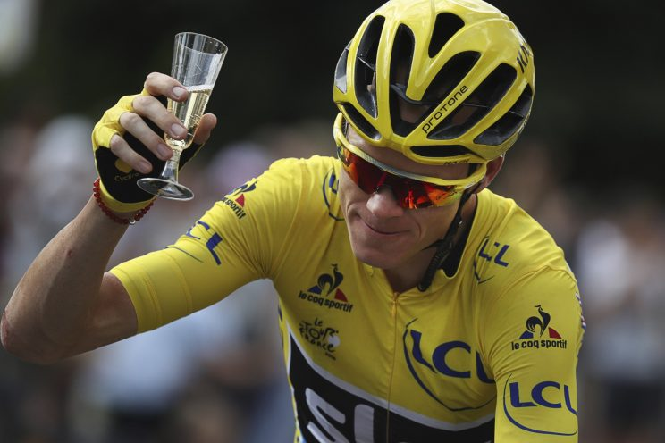 Britain's Chris Froome, wearing the overall leader's yellow jersey, celebrates with a glass of champagne during the twenty-first stage of the Tour de France cycling race over 113 kilometers (70.2 miles) with start in Chantilly and finish in Paris, France, Sunday, July 24, 2016. (Kenzo Tribouillard via AP Photo)