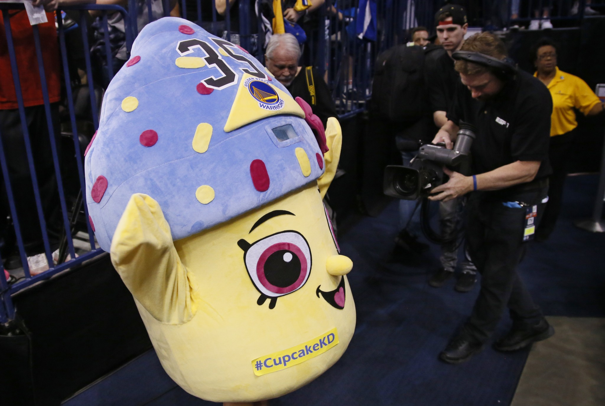 A young Thunder fan wears a cupcake costume before an NBA basketball game between the Golden State Warriors and the Oklahoma City Thunder in Oklahoma City, Saturday, Feb. 11, 2017. (AP/Sue Ogrocki)