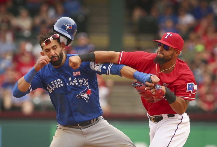 Rougned Odor punches Jose Bautista in the face. (Getty Images/Fort Worth Star-Telegram)